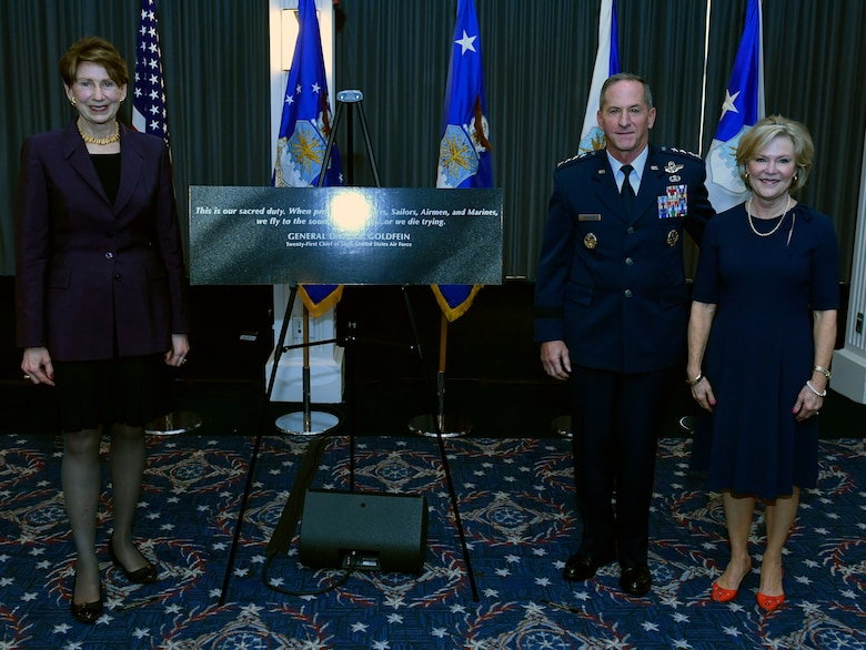"Secretary of the Air Force Barbara M. Barrett, left, Air Force Chief of Staff David L. Goldfein and Mrs. Dawn Goldfein pose with a representation of an etching that is now displayed on the Wall of Valor at the Air Force Memorial during a ceremony at Joint Base Anacostia-Bolling, Washington, D.C., July 31, 2020. The ceremony unveiled a new etching for the memorial's Wall of Valor at the Air Force Memorial that reads, ""This is our sacred duty. When protecting Soldiers, Sailors, Airmen and Marines, we fly to the sound of the guns … or we die trying."" (U.S. Air Force photo by Wayne Clark)"