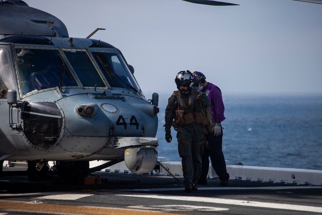 A U.S. Navy MH-60 Seahawk pilot returns to the amphibious assault ship USS Makin Island during ongoing search and rescue operations following an AAV-P7/A1 assault amphibious vehicle mishap off the coast of Southern California, July 30, 2020. Assisting in the search and rescue operations are the guided-missile destroyer USS John Finn, multiple U.S. Navy MH-60 helicopters and small boats from USS Makin Island, the amphibious transport dock USS Somerset, the amphibious transport dock USS San Diego, as well as the U.S. Coast Guard Cutter Forrest Rednour and a Coast Guard MH-60 Jayhawk helicopter from Coast Guard Sector San Diego.