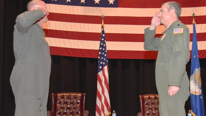 Lt. Col. Terry McGee, outgoing 924th Air Refueling Squadron commander, right, relinquishes command during a change of command ceremony Aug. 2, 2020, at McConnell Air Force Base, Kansas. McGee has been the commander of the 924 ARS since it was reactivated in 2017.  The 924 ARS is one of the Reserve KC-46 Air Refueling Squadrons at Team McConnell.