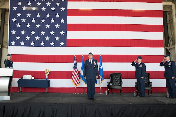 Maj. Gen. John Healy, 22nd Air Force commander, stands center stage while members of the 302nd Airlift Wing salute him.