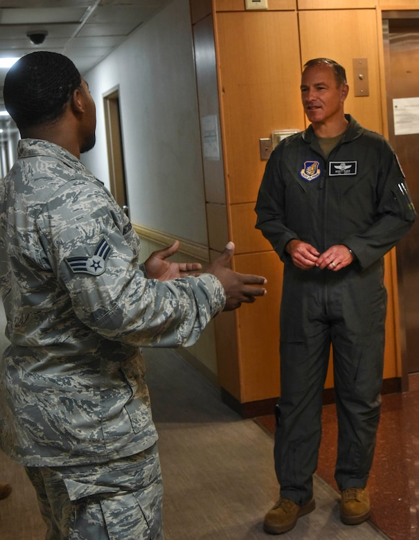 Senior Airman Kevin Witherspoon, 8th Civil Engineering Squadron heating, ventilation, air conditioning and refrigeration technician, briefs Lt. Gen. Scott Pleus, Seventh Air Force commander, on issues within the dorms on Kunsan Air Base, July 29, 2020.