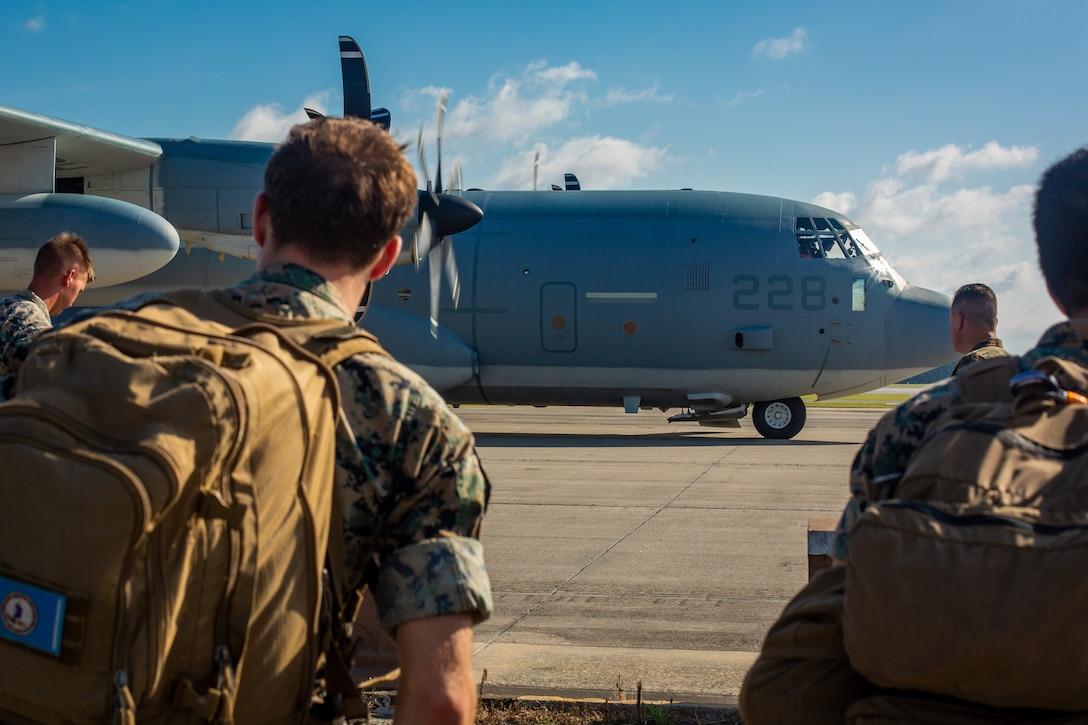 U.S. Marines standby to enter a KC-130J Hercules at Marine Corps Air Station Cherry Point, North Carolina, July 31.