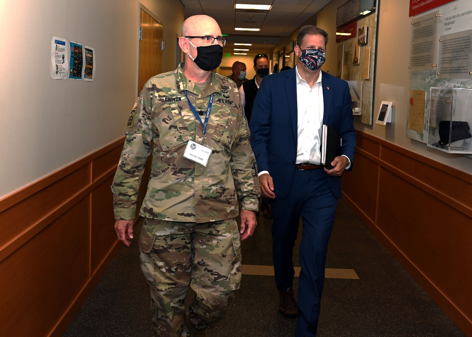 Lt. Col. Woody Groton, exercise director of Cyber Yankee 2020, leads N.H. Gov. Chris Sununu on a tour of the event on July 31, 2020, at the Edward Cross Training Center in Pembroke, N.H.