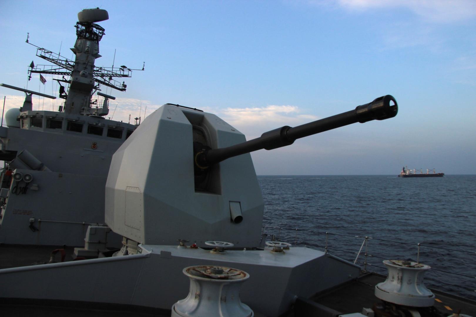 Merchant Vessel being reassured by HMS MONTROSE on IMSC Tasking