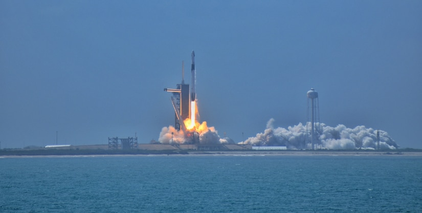 A rocket lifts off from a launch pad.