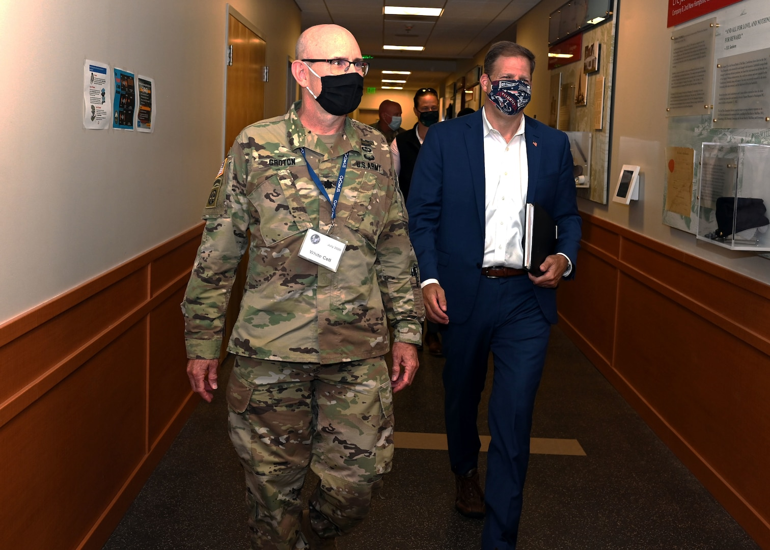 New Hampshire National Guard Lt. Col. Woody Groton, exercise director of Cyber Yankee 2020, leads New Hampshire Gov. Chris Sununu on a tour of the event on July 31, 2020, at the Edward Cross Training Center in Pembroke, N.H. The two-week regional exercise enhanced the Guard's ability to respond to cyberattacks against state government and critical infrastructure.