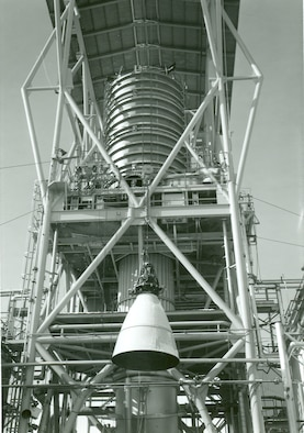 The rocket motor for the Apollo Service Module is installed for testing in J-3 at Arnold Air Force Base in 1966. The motor was repeatedly test fired in near space conditions to help NASA qualify the system as man-rated for the flight to the moon. This year marks the 60th anniversary of completion of the construction on J-3 and the initiation of the first operational test in the cell. (U.S. Air Force photo)