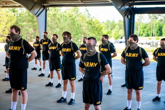 BCT Trainees stand in formation while adhering to COVID-19 safety measures.