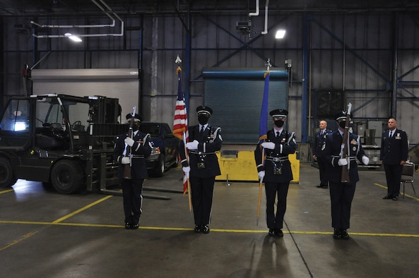 445th Airlift Wing Honor Guard members posts the Colors at the 87th Aerial Port Squadron Change of Command July 11, 2020 at Wright-Patterson Air Force Base. Being a member of the honor guard requires commitment, responsibility and a strong sense of purpose. It also requires a face mask mandated as one of the safety precautions due to COVID-19. Honor guard resumed attending official wing functions at the beginning July. (U.S. Air Force photo/Senior Airman Angela Jackson)