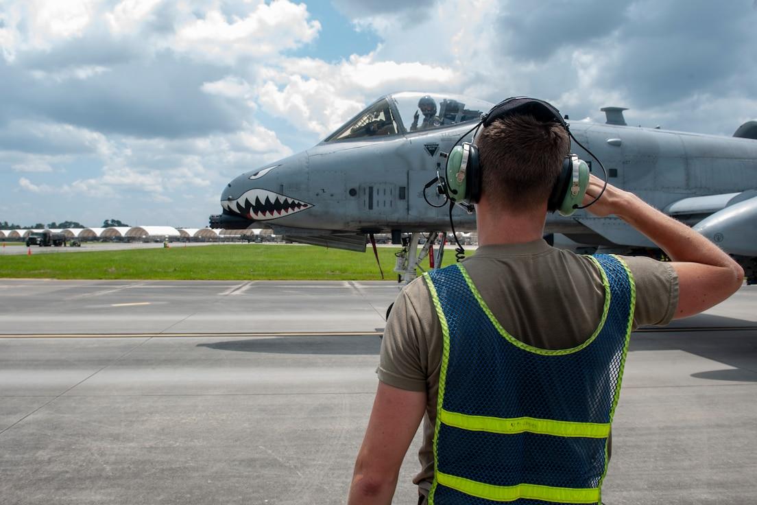 A photo of an Airman saluting a pilot.