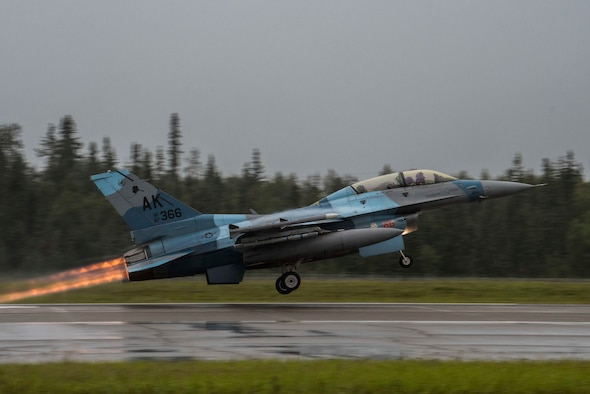 A U.S. Air Force F-16 Fighting Falcon, assigned to the 18th Aggressor Squadron, takes off during RED FLAG-Alaska (RF-A) 20-3 at Eielson Air Force Base, Alaska, Aug. 3, 2020. RF-A gives aviators an opportunity to hone skills required in combat by providing training scenarios designed to replicate near-peer adversary tactics, techniques and procedures in a controlled environment. (U.S. Air Force photo by Airman 1st Class Aaron Larue Guerrisky)