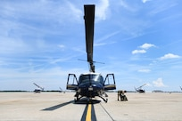 Lt. Col. Scott Dunning, 2nd Lt. Andre Young and Staff Sgt. Adrian Acasio, flight crew from the 1st Helicopter Squadron, prepare for takeoff on Joint Base Andrews, Md., July 30, 2020.