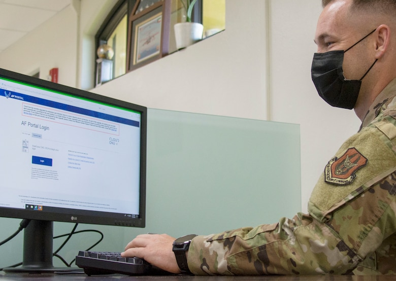 A photo of U.S. Air Force Master Sgt. David Popp, 44th Aerial Port Squadron assistant aerial port manager, signing onto a newly installed computer at Andersen Air Force Base, Guam, July 28, 2020. The Reserve Citizen Airman was part of a team that conducted a workspace utilization study that led to the creation of his squadron's first phase of their cybercafe. (U.S. Air Force photo by Tech. Sgt. Tricia C. Topasna)