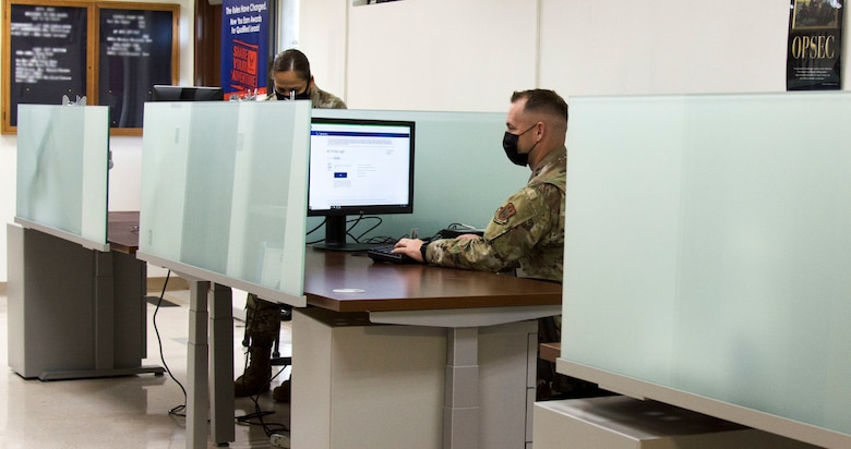 Photo of U.S. Air Force Master Sgt. Louisa Togawa, left, and Master Sgt. David Popp of the 44th Aerial Port Squadron utilizing the recently built cybercafe at Andersen Air Force Base, Guam, July 28, 2020. The cybercafe was created to increase internet accessibility by optimizing workspace utilization through the use of squadron innovation funds from AFWERX, the Air Force's innovation program. (U.S. Air Force photo by Tech. Sgt. Tricia C. Topasna)