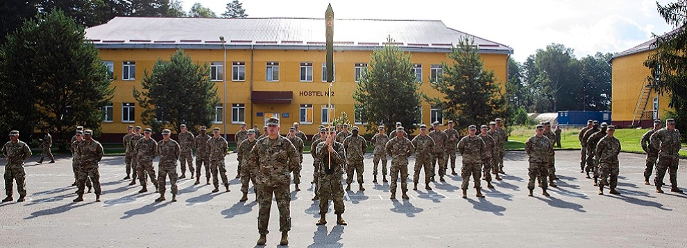 Soldiers with Task Force Illini, 33rd Infantry Brigade Combat Team, Illinois National Guard stand at parade rest during a transfer of authority ceremony where Task Force Illini assumed command of Joint Multinational Training Group-Ukraine at Collective Training Center –Yavoriv, Ukraine, July 30, 2020. (U.S. Army photo by Sgt. Gregory Glosser)