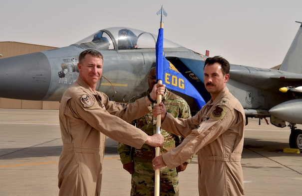 Col. Hurrelbrink, outgoing commander, relinquishes command of the 378th Expeditionary Operations Group to incoming commander, Col. Orgeron during the 378th EOG Change of Command Ceremony at Prince Sultan Air Base, Kingdom of Saudi Arabia.