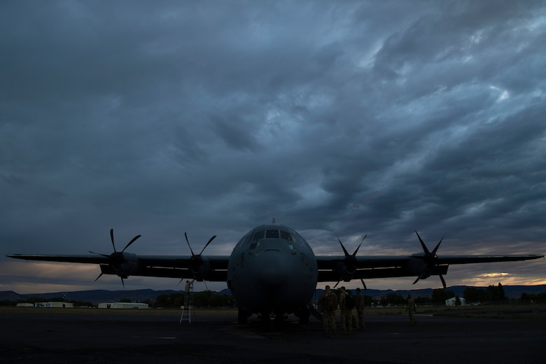 Airmen from the 19th Aircraft Maintenance Squadron finish up maintenance as pilots from the 41st Airlift Squadron prepare to board a C-130J Super Hercules during pre-deployment training at Montrose Regional Airport, Colorado, July 27, 2020. The 4/12 deployment initiative, which was developed in 2019 between airlift squadrons from Dyess AFB, Texas and Little Rock AFB, allowing each squadron a full year of dwell time followed by a four-month rotation to their respective area of responsibility. (U.S. Air Force photo by Airman 1st Class Aaron Irvin)