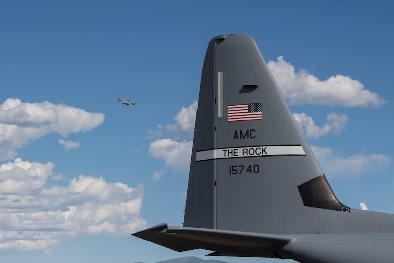 A C-130J Super Hercules assigned to the 41st Airlift Squadron flies above the flightline during pre-deployment training at Montrose Regional Airport, Colorado, July 29, 2020. This training environment helped the 41st AS familiarize the crews to mountainous terrain and high pressure altitudes similar to what they will encounter in their area of responsibility overseas. (U.S. Air Force photo by Airman 1st Class Aaron Irvin)