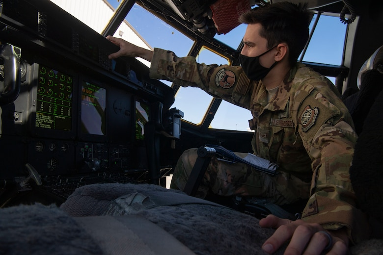 Airman 1st Class Cameron Bou, 41st Airlift Squadron loadmaster, prepares a C-130J Super Hercules for flight during pre-deployment training at Montrose Regional Airport, Colorado, July 27, 2020. This training was part of the 4/12 deployment initiative, which was developed in 2019 between airlift squadrons from Dyess Air Force Base, Texas and Little Rock AFB, allowing each squadron a full year of dwell time followed by a four-month rotation to their respective area of responsibility. (U.S. Air Force photo by Airman 1st Class Aaron Irvin)