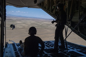 Airman 1st Class Cameron Bou (left) and Senior Airman Kirk Mumau (right), 41st Airlift Squadron loadmasters, conduct an airdrop over Reed Drop Zone in Colorado July 27, 2020. This training is part of the 4/12 deployment initiative, which was developed in 2019 between airlift squadrons from Dyess Air Force Base, Texas and Little Rock AFB, allowing each squadron a full year of dwell time followed by a four-month rotation to their respective area of responsibility. (U.S. Air Force photo by Airman 1st Class Aaron Irvin)