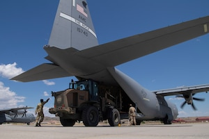 Airmen assigned to the 821st Contingency Response Squadron load cargo onto a C-130J Super Hercules during pre-deployment training at Guernsey Airport, Wyoming, July 27, 2020. This training is part of the 4/12 deployment initiative, which was developed in 2019 between airlift squadrons from Dyess Air Force Base, Texas and Little Rock AFB, allowing each squadron a full year of dwell time followed by a four-month rotation to their respective area of responsibility. (U.S. Air Force photo by Airman 1st Class Aaron Irvin)