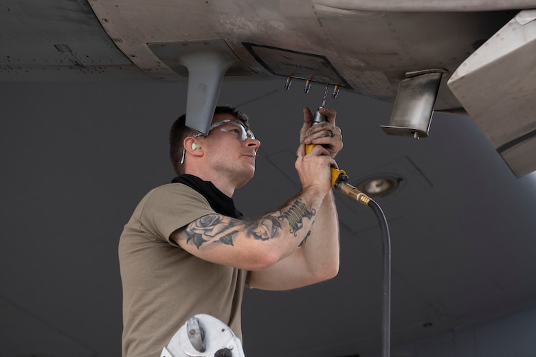A maintainer from the 19th Aircraft Maintenance Squadron services a C-130J Super Hercules during pre-deployment training at Montrose Regional Airport, Colorado, July 27, 2020. This training is part of the 4/12 deployment initiative, which was developed in 2019 between airlift squadrons from Dyess Air Force Base, Texas and Little Rock AFB, allowing each squadron a full year of dwell time followed by a four-month rotation to their respective area of responsibility. (U.S. Air Force photo by Airman 1st Class Aaron Irvin)