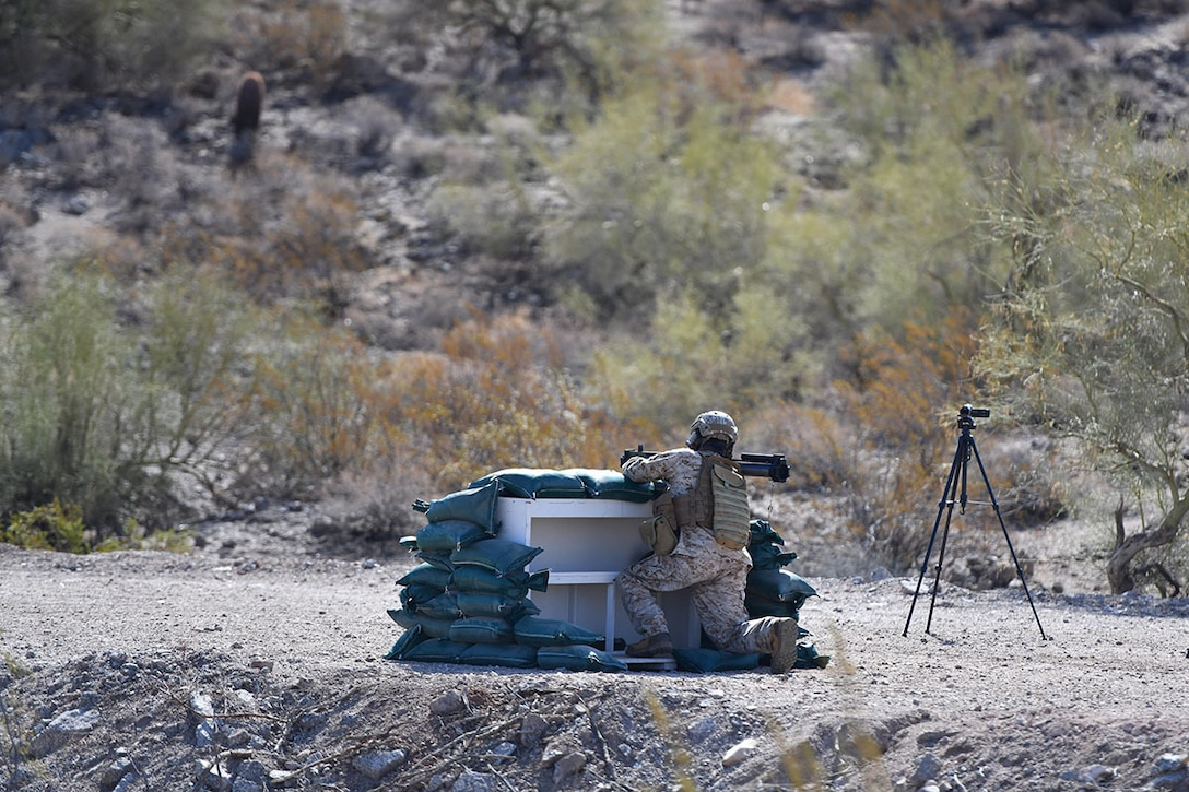 A test facility professional prepares to fire an M72 LAW Fire from Enclosure test round at an undisclosed test range in 2019.