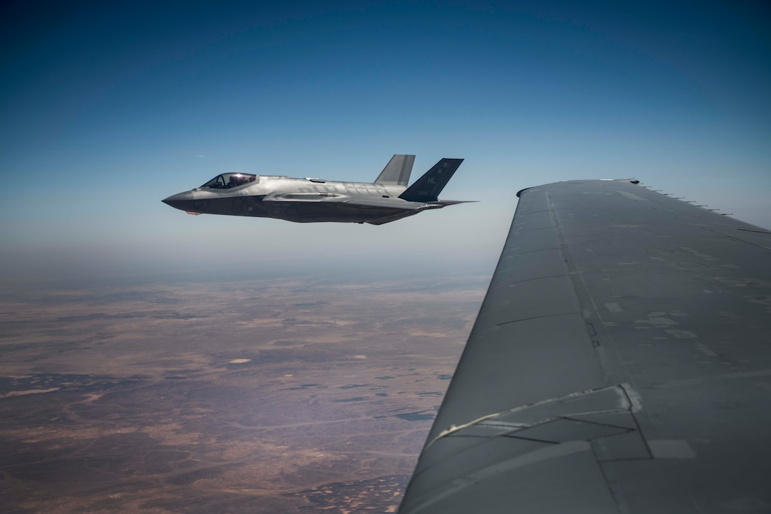 """A U.S. Air Force 421st Fighter Squadron F-35A Lightning II flies next to a 908th Expeditionary Refueling Squadron KC-10 Extender after refueling during """"Enduring Lightning II"""" exercise over Israel Aug. 2, 2020. The exercise included both U.S. and Israeli forces whom trained to maintain readiness and to defend the region together. (U.S. Air Force photo by Master Sgt. Patrick OReilly)"""