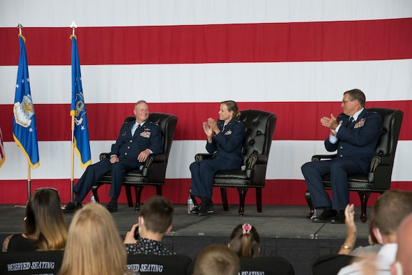 Col. Kandace Steinbrink (middle), U.S. Space Command Human Capital deputy director, and retired Air Force Lt. Col. Edward Strickland (right) applaud Col. James DeVere