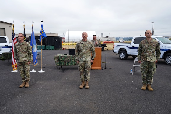 U.S. Air Force Lt. Col. Ryan Barton, center, assumes command of the 142nd Security Forces Squadron from Lt. Col. Caleb Westfall, right, during a change of command ceremony at the Portland Air National Guard Base, Ore., Aug. 2, 2020. Westfall retired directly after the change of command.