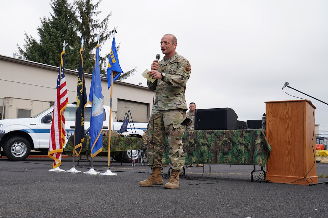 U.S. Air Force Lt. Col. Ryan Barton, incoming 142nd Security Forces commander, gives remarks during a change of command ceremony at the Portland Air National Guard Base, Ore., Aug. 2, 2020. A limited number of family and Airmen attended the event due to COVID-19 restrictions.