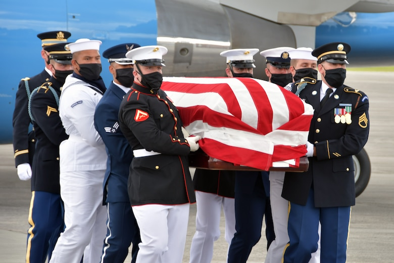 An Armed Forces Body Bearer Team carries the flag-draped casket of Rep. John Lewis at Dobbins Air Reserve Base, Georgia, July 29, 2020. DoD personnel are honoring the congressman by providing military funeral honors during his congressional funeral events. (U.S. Air Force photo by Airman 1st Class Kendra A.  Ransum)