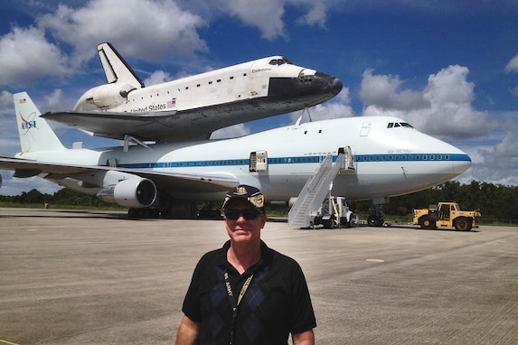 U.S. Army Reserve Lt. Col. Pat Lis stands in front of a Boeing 747-100 National Aeronautics and Space Administration Shuttle Carrier Aircraft that is carrying the Space Shuttle Endeavor at the Kennedy Space Center in Florida.