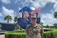 U.S. Army Reserve Lt. Col. Pat Lis pauses for a photo at the entrance to the Kennedy Space Center Visitor Complex in Florida. Lis credits the U.S. Army to his success working 33 years in the aerospace industry.