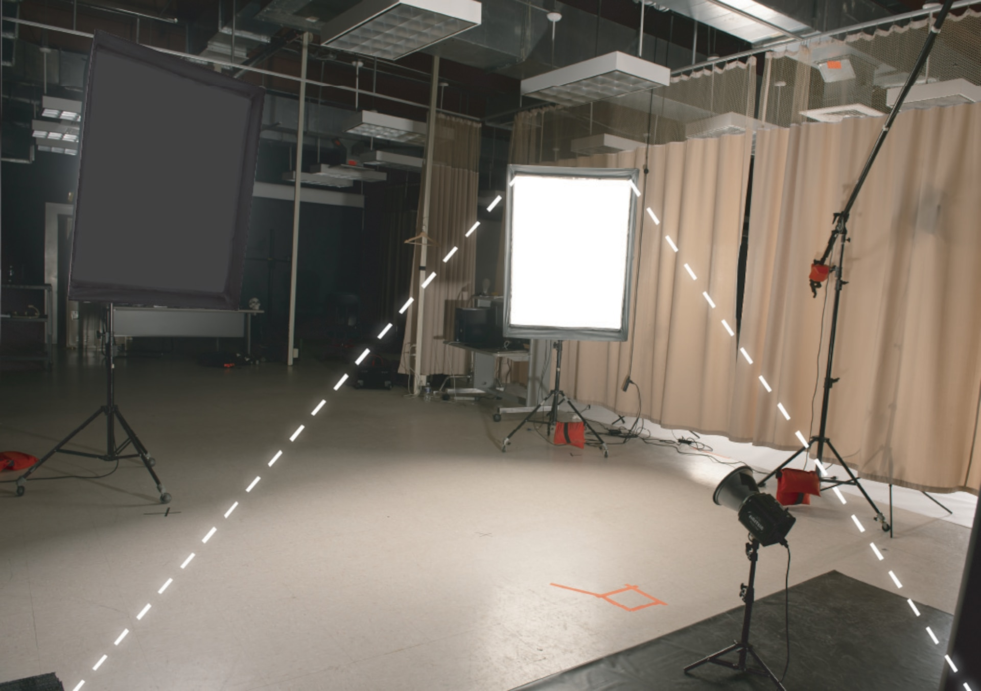 The fill light that fills in or lightens any shadows produced by the main light in a studio setting.