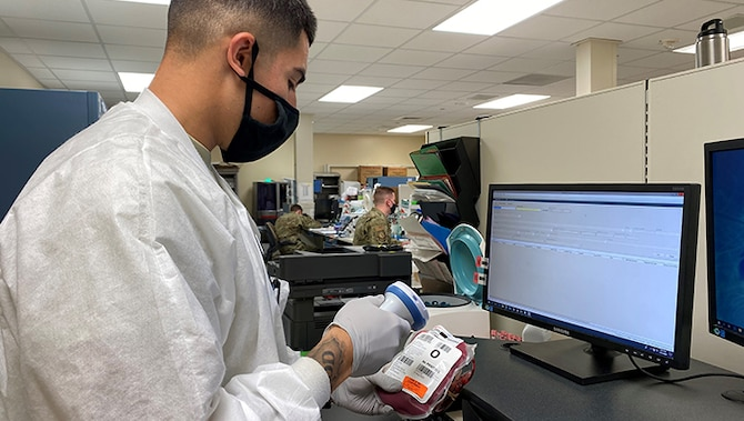 Image of an Airman scanning a unit of blood.