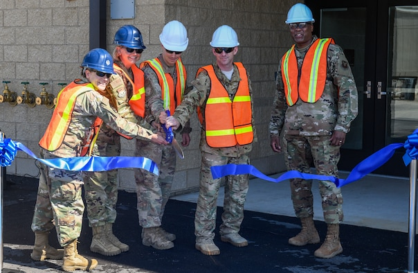 Leadership of the 341st Missile Wing cut a ribbon during the ceremony for the new Tactical Response Force/Helicopter Operations Alert Facility Aug. 4, 2020, at Malmstrom Air Force Base, Mont.