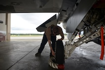 U.S. Air Force Senior Airman Joshua Zacharko, an 18th Aircraft Maintenance Unit (AMU) crew chief, inspects landing gear on an F-16 Fighting Falcon aircraft during RED FLAG-Alaska 20-3 on Eielson Air Force Base, Alaska, Aug. 4, 2020. The 18th AMU provides mission-ready maintainers to support the wing's aggressor missions and exercises throughout the Indo-Pacific region. (U.S. Air Force photo by Senior Airman Beaux Hebert)