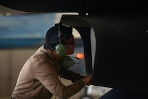 U.S. Air Force Airman 1st Class Jacob Camacho, an 18th Aircraft Maintenance Unit (AMU) crew chief, inspects an F-16 Fighting Falcon air intake during RED FLAG-Alaska 20-3 on Eielson Air Force Base, Alaska, Aug. 4, 2020. Prior to starting up the jet, crew chiefs look for debris that could potentially create a safety hazard. (U.S. Air Force photo by Senior Airman Beaux Hebert)