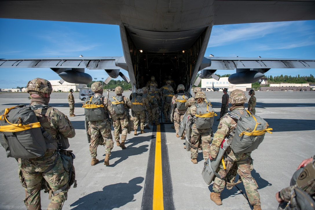 Army soldiers board a C-310 aircraft.
