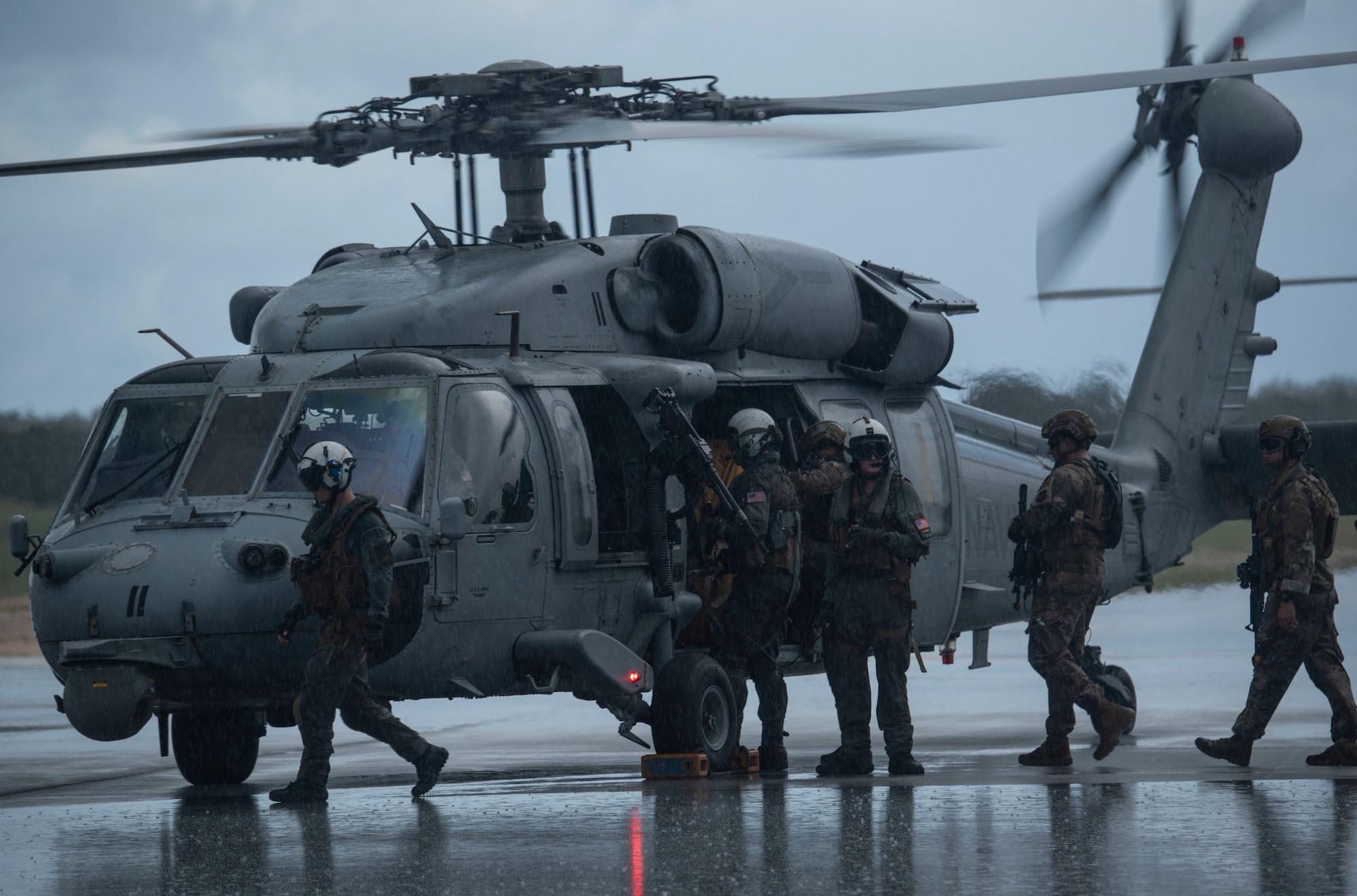 Airmen enter helicopter