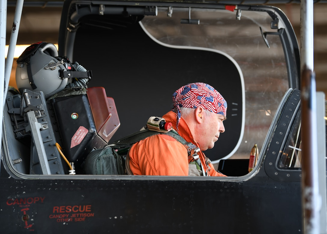 Retired Lt. Col Jonathan Huggins, 1st Reconnaissance Squadron U-2 instructor pilot, performs a preflight inspection before takeoff July 31, 2020 at Beale Air Force Base, California. Civilian U-2 instructor pilots don an orange flight suit, symbolic to the history of the U-2 pilots who wore them in the past. (U.S. Air Force photo by Airman 1st Class Luis A. Ruiz-Vazquez)