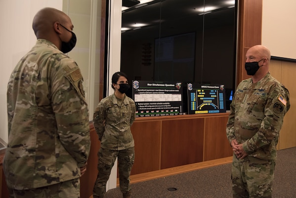 Gen. Jay Raymond, U.S. Space Force Chief of Space Operations and commander of U.S. Space Command, is briefed by 1st Lt. Melanie Mohseni and 1st Lt. Byron Baker, 2nd Range Operation Squadron, while touring the 30th Space Wing's Western Range Operation Control Center Aug. 3, 2020 at Vandenberg Air Force Base, Calif.
