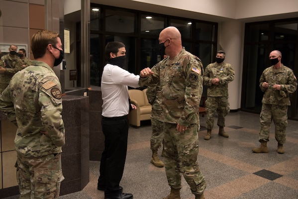 Gen. Jay Raymond, U.S. Space Force Chief of Space Operations and commander of U.S. Space Command, Chief Master Sgt. Roger A. Towberman, U.S. Space Force Senior Enlisted Advisor, are greeted by 30th Space Wing members at the 30th SW's Western Range Operation Control Center Aug. 3, 2020 at Vandenberg Air Force Base, Calif.