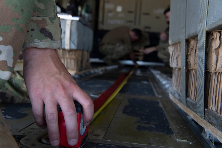 Airman 1st Class Cameron Bou, 41st Airlift Squadron loadmaster, prepares a C-130J Super Hercules for loading operations during pre-deployment training at Montrose Regional Airport, Colorado, July 27, 2020. This training is part of the 4/12 deployment initiative, which was developed in 2019 between airlift squadrons from Dyess Air Force Base, Texas and Little Rock AFB, allowing each squadron a full year of dwell time followed by a four-month rotation to their respective area of responsibility. (U.S. Air Force photo by Airman 1st Class Aaron Irvin)
