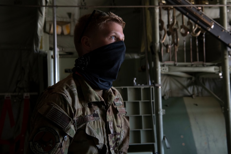 Senior Airman Kirk Mumau, 41st Airlift Squadron loadmaster, prepares a C-130J Super Hercules for flight during pre-deployment training at Montrose Regional Airport, Colorado, July 27, 2020. This training is part of the 4/12 deployment initiative, which was developed in 2019 between airlift squadrons from Dyess Air Force Base, Texas and Little Rock AFB, allowing each squadron a full year of dwell time followed by a four-month rotation to their respective area of responsibility. (U.S. Air Force photo by Airman 1st Class Aaron Irvin)