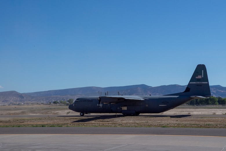 A C-130J Super Hercules prepares for takeoff during pre-deployment training at Montrose Regional Airport, Colorado, July 27, 2020. This training is part of the 4/12 deployment initiative, which was developed in 2019 between airlift squadrons from Dyess Air Force Base, Texas and Little Rock AFB, allowing each squadron a full year of dwell time followed by a four-month rotation to their respective area of responsibility. (U.S. Air Force photo by Airman 1st Class Aaron Irvin)