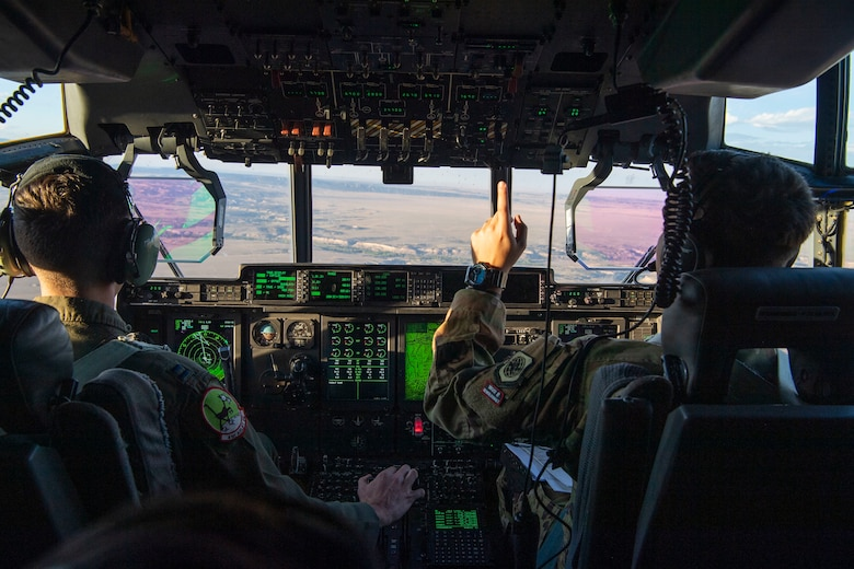 Pilots from the 41st Airlift Squadron fly a C-130J Super Hercules during pre-deployment training in Colorado, July 30, 2020. Throughout the training, the 41st AS was able to perform airdrops, offload cargo, fly low-levels, land on dirt runways, integrate with other wings, operate in low-light environments and navigate topography that the squadron is unable to replicate at home station. (U.S. Air Force photo by Airman 1st Class Aaron Irvin)
