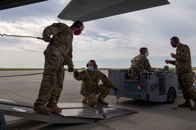 Members from the 41st Airlift Squadron and the 140th Wing, Colorado Air National Guard load cargo onto a C-130J Super Hercules during pre-deployment training at Buckley Air Force Base, Colorado, July 27, 2020. The 4/12 deployment initiative, which was developed in 2019 between airlift squadrons from Dyess AFB, Texas and Little Rock AFB, allowing each squadron a full year of dwell time followed by a four-month rotation to their respective area of responsibility. (U.S. Air Force photo by Airman 1st Class Aaron Irvin)