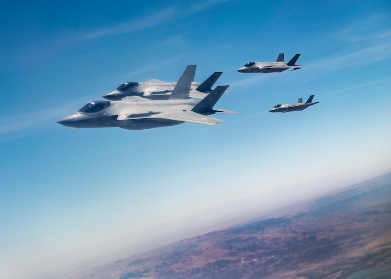 """Israeli Air Force F-35I Lightning II """"Adir"""" and U.S. Air Force 421st Fighter Squadron F-35A Lightning II  fly together after refueling from a 908th Expeditionary Refueling Squadron KC-10 Extender during exercise """"Enduring Lightning II"""" over Israel Aug. 2, 2020. While forging a resolute partnership, the allies train to maintain a ready posture to deter against regional aggressors.  (U.S. Air Force photo by Master Sgt. Patrick OReilly)"""